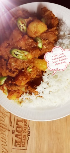 Lamb Curry With Soft Potatoes Paired With White Basmati Rice