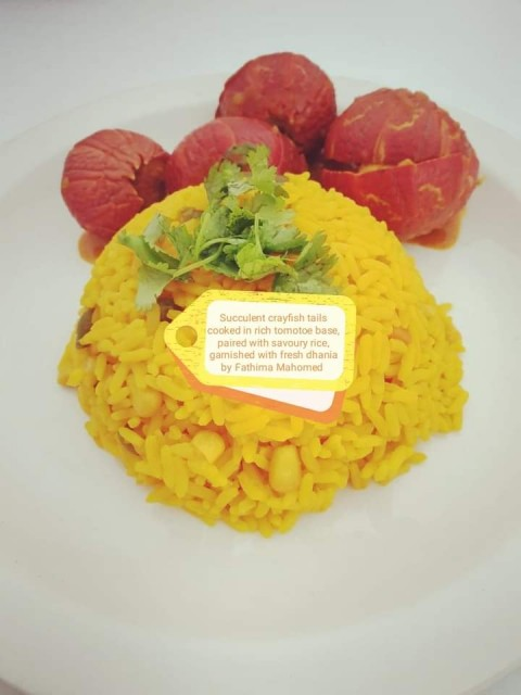 Succulent Crayfish Tails Cooked In Rich Fresh Cream, Tomotoe Base, Paired With Savoury Rice