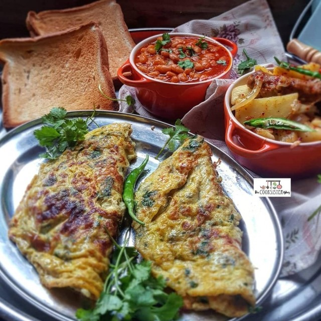 Green Masala Omelet And Spicy Sausage And Potato Fry
