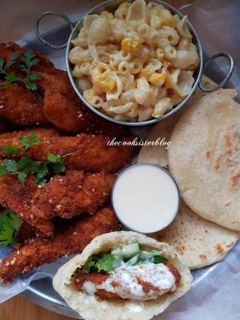Chicken Strips Served With Macaroni And Cheese.