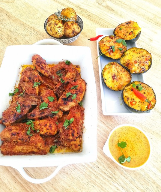 Taka Taka Chicken Served With Mexican Style Stuffed Gemsquash And Cajun Flavored Roasted Baby Potatoes