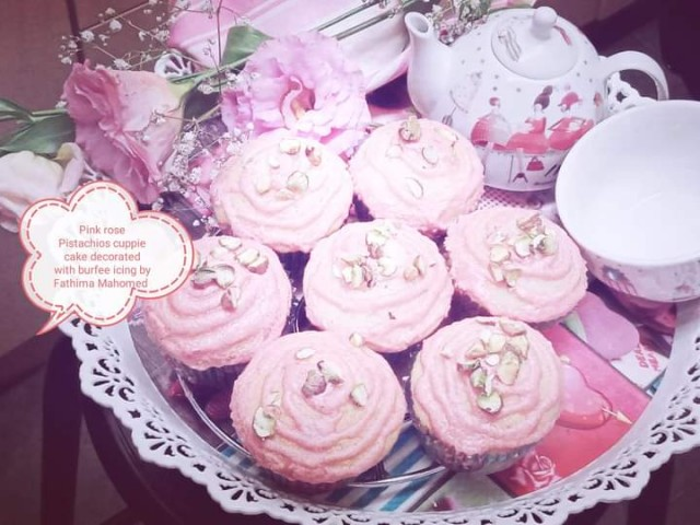 Pink Rose Pistachio Cuppie Cake Decorated With Burfee Icing